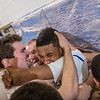 Senior Andrew Kelly is mobbed by his teammates moments after scoring at the buzzer to lead the Nanooks to an incredible come-from-behind victory over the UAA Seawolves on Senior Night in the Patty Gym.  Filename: ATH-14-4097-48.jpg