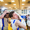 Senior Andrew Kelly is mobbed by his teammates moments after scoring at the buzzer to lead the Nanooks to an incredible come-from-behind victory over the UAA Seawolves on Senior Night in the Patty Gym.  Filename: ATH-14-4097-58.jpg