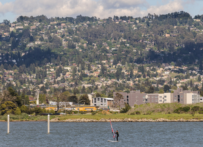 A windsurfer rides in San Francisco Bay in front of the Berkeley Hills. (04/03/14, 7:12:26 AM)