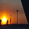 Mihir Shetye and his wife, Nidhi, visiting Fairbanks from their home in Los Angeles, pause outside the UA Museum of the North to take photos of another spectacular Interior Alaska sunset.