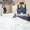 "A Facilities Services crew member clears fresh snow from walkways around the Fairbanks campus on the first day of classes in the Spring 2014 semester.  <div class=""ss-paypal-button"">Filename: CAM-14-4038-11.jpg</div><div class=""ss-paypal-button-end""></div>"