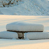 """A picnic table waits for warmer temperatures during a January afternoon on the Fairbanks campus.  <div class=""""ss-paypal-button"""">Filename: CAM-14-4039-1.jpg</div><div class=""""ss-paypal-button-end""""></div>"""