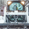 """A Facilities Services crew member clears fresh snow from walkways around the Fairbanks campus on the first day of classes in the Spring 2014 semester.  <div class=""""ss-paypal-button"""">Filename: CAM-14-4038-1.jpg</div><div class=""""ss-paypal-button-end""""></div>"""