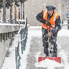 Maintenance crew foreman Raif Kennedy works to clear a path in front of the Rasmuson Library during a brief but heavy snowfall Nov. 5 on the Fairbanks campus.  Filename: CAM-13-3993-14.jpg