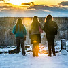 "Three students pause to watch a January sunset during a warm afternoon on the Fairbanks campus.  <div class=""ss-paypal-button"">Filename: CAM-14-4039-60.jpg</div><div class=""ss-paypal-button-end""></div>"