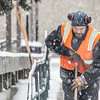 Maintenance crew foreman Raif Kennedy works to clear a path in front of the Rasmuson Library during a brief but heavy snowfall Nov. 5 on the Fairbanks campus.  Filename: CAM-13-3993-10.jpg