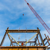 "A 220-foot crane lowers steel beams into position as workers secure it during construction of the new engineering facility on the Fairbanks campus in April, 2014.  <div class=""ss-paypal-button"">Filename: CAM-14-4131-31.jpg</div><div class=""ss-paypal-button-end""></div>"