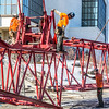 "Workers assemble the pieces of a 220-foot crane used to install steel beams on the new expansion of the Duckering Building.  <div class=""ss-paypal-button"">Filename: CAM-14-4122-27.jpg</div><div class=""ss-paypal-button-end"" style=""""></div>"