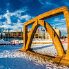 The 2013 ice arch, designed and built on the Fairbanks campus each spring by engineering students, was constructed of pykrete - a combination of water and sawdust.  Filename: CAM-13-3756-32.jpg