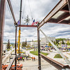 "Iron workers with Davis Constructors secure the final steel beam into position in UAF's new engineering facility this afternoon while a crowd of university, legislative and business leaders look on. The final piece of steel is topped with Alaska and U.S. flags and, following an ancient  Scandinavian tradition, a small tree.   <div class=""ss-paypal-button"">Filename: CAM-14-4199-119.jpg</div><div class=""ss-paypal-button-end""></div>"
