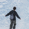 "A student slides down the hill by the Patty Center during a warm January afternoon on the Fairbanks campus.  <div class=""ss-paypal-button"">Filename: CAM-14-4039-90.jpg</div><div class=""ss-paypal-button-end""></div>"