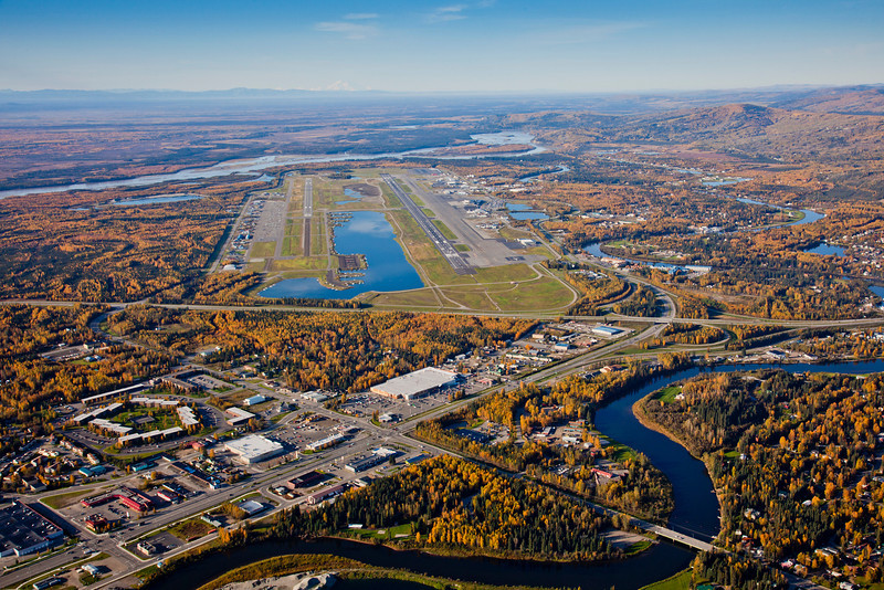 An aerial view of Fairbanks looking south toward the confluence of the Chena and Tanana Rivers with the airport on the left and Mt. McKinley on the horizon.