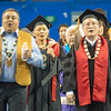 Members of the Downriver Singers, led by honorary degree recipient John Sacket at front right, led the ceremonial processional  at the start of the ceremony.  Filename: GRA-13-3827-0065.jpg