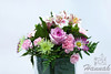 A bunch of assorted flowers on a clear vase with white background<br /> <br /> © Copyright Hannah Pastrana Prieto