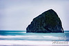 View of Haystack Rock located near Cape Kiwanda in the Oregon Coast ... if you look in closer you will see some seabirds resting on top of this rock.  © Copyright Hannah Pastrana Prieto
