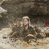 "Nine-year-old Rosie Paris had a good time playing in the pit during Mud Day in the Georgeson Botanical Garden, sponsored by UAF's School of Natural Resources and Extension.  <div class=""ss-paypal-button"">Filename: LIF-14-4212-53.jpg</div><div class=""ss-paypal-button-end""></div>"