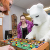 The UAF mascot enjoys a game of foosball with colleagues in an Eielson Building office.  Filename: LIF-14-4101-7.jpg