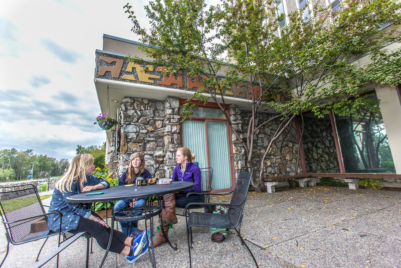 """Biology majors Hannah Wing, left, Joanna Jagow and Emily Koenig enjoy a snack in front of the MBS complex after their first day of class.  <div class=""""ss-paypal-button"""">Filename: LIF-13-3928-274.jpg</div><div class=""""ss-paypal-button-end"""" style=""""""""></div>"""