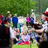Scores of people listen to the Red Hackle Pipe Band during the kick-off event of Summer Sessions' Music in the Garden Series at the Georgeson Botanical Garden.  Filename: LIF-12-3426-6.jpg