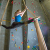 Miriam Brooks practices her silk climbing skills on the climbing wall in the SRC.  Filename: LIF-13-3819-33.jpg