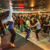 """Students learn some new steps during a Latin Dance evening in the Wood Center Pub, one of many events in the 2014 UAF Winter Carnival.  <div class=""""ss-paypal-button"""">Filename: LIF-14-4086-17.jpg</div><div class=""""ss-paypal-button-end"""" style=""""""""></div>"""