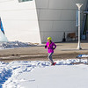 One of the leaders in the second annual Troth Yeddha' Park Snowshoe Scramble makes her way past the museum Saturday, March 1 to help raise awareness for the proposed park to help celebrate Alaska's Native culture.  Filename: LIF-14-4079-33.jpg