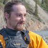 Expedition leader Bryson DeRonde takes a break on shore during a day-long raft trip down a beautiful stretch of the Nenana River offered by UAF Outdoor Adventures.  Filename: OUT-12-3492-096.jpg