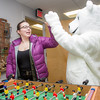 The UAF mascot enjoys a game of foosball with colleagues in an Eielson Building office.  Filename: LIF-14-4101-11.jpg