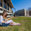 UAF student Kaylee Miltersen works on her homework in the April sunshine outside the library.  Filename: LIF-12-3356-78.jpg