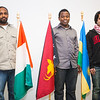 Students from left, Abraham Endalamaw of Ethiopia, Bertrand Dushime of Rwanda and Fahad Alshamman of Saudi Arabia stand beside the flags representing their country after a dedication ceremony at the Wood Center.  Filename: LIF-12-3655-59.jpg