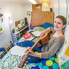 Music major Kaylie Wiltersen practices the guitar in her Skarland Hall single room.  Filename: LIF-13-3735-58.jpg