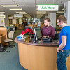 Staff librarian Paul Adasiak helps music major Campbell Longworth with a reference question in the UAF Rasmuson Library on the Fairbanks campus.  Filename: LIF-14-4045-182.jpg