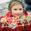 "Mika Maya Grubis holds her handmade gumdrop bridge during the during the E-Week open house in the Duckering Building.  <div class=""ss-paypal-button"">Filename: LIF-13-3741-69.jpg</div><div class=""ss-paypal-button-end"" style=""""></div>"