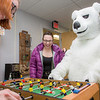 The UAF mascot enjoys a game of foosball with colleagues in an Eielson Building office.  Filename: LIF-14-4101-9.jpg
