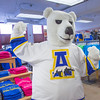 The UAF mascot tries on a new jersey in the UAF Bookstore in Constitution Hall.  Filename: LIF-14-4101-41.jpg