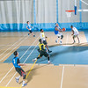 Intramural basketball action on a Tuesday night at the Student Recreation Center.  Filename: LIF-14-4111-302.jpg