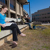 Rebekah Tsigonis goes barefoot while enjoying some nice weather outside on campus after a long winter.  Filename: LIF-12-3356-51.jpg