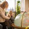 Jaimee Coon points out some features on the globe while visiting the Rasmuson Library with her third grade daughter Amaya.  Filename: LIF-14-4045-94.jpg