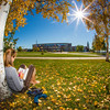 Emily Russell, a new graduate student in Northern Studies, takes advantage of nice September weather on the Fairbanks campus.  Filename: LIF-12-3540-02.jpg