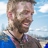 Cyrus Bee  is all smiles after a round of mud volleyball during Spring Fest.  Filename: LIF-12-3376-197.jpg