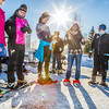 Participants in the second annual Troth Yeddha' Snowshoe Run line up near the starting line before the race Saturday, March 1 by the Reichardt Building. The event hopes to build awarness for a proposed park to help celebrate Alaska's Native culture.  Filename: LIF-14-4079-8.jpg