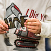 Cooper Mitchell holds a UAF steel cutout during  the annual Eweek open house in the Duckering Building on campus.  Filename: LIF-13-3741-119.jpg