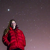 "Senior geology major Jessica Eicher stands under a starry sky on a mile February night near the Fairbanks campus. Eicher is one of 1,058 finalists from among more than 200,000 people who applied to join the Mars One mission. Mars One, a nonprofit based in The Netherlands, wants to begin sending groups of four individuals on one-way trips to the Red Planet starting in 2025. ""Once on Mars there are no means to return to Earth. Mars is home,"" the group's website explains.  Filename: LIF-14-4092-14.jpg"