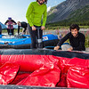 Participants in a UAF Outdoor Adventures day-long raft trip prepare to paddle down the Nenana River.  Filename: OUT-12-3492-011.jpg