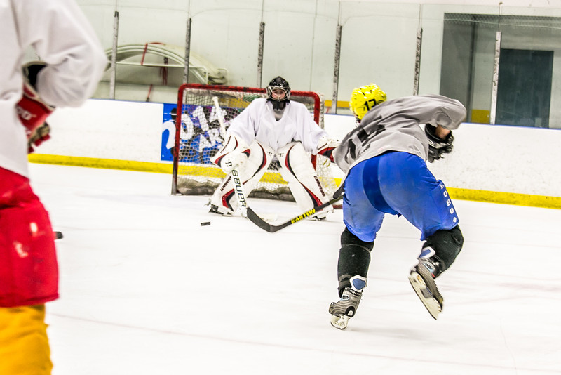 Intramural hockey action on a Tuesday night at the Patty Ice arena.  Filename: LIF-14-4111-379.jpg