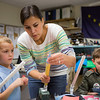 Charlotte LaRue helps son Braun Endicott with his paper rocket during the E-Week open house in the Duckering Building.  Filename: LIF-13-3741-14.jpg