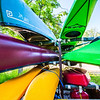 Canoes and kayaks rest on racks near UAF's Wood Center when not being used by the Outdoor Adventures program.  Filename: LIF-12-3476-07.jpg