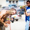 "Fabienne Clerc hoses off Michael Weingartner after a game of mud volleyball during the 2012 Spring Fest tournament.  <div class=""ss-paypal-button"">Filename: LIF-12-3378-37.jpg</div><div class=""ss-paypal-button-end"" style=""""></div>"