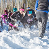 Participants in the second annual Troth Yeddha' Snowshoe Scramble dig for prizes buried in the snow after the race Saturday, March 1 by the Reichardt Building. The event hopes to build awarness for a proposed park to help celebrate Alaska's Native culture.  Filename: LIF-14-4079-102.jpg