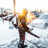 """A groundskeeper on the Facilities Services crew clears campus sidewalks after a February morning snowfall.  <div class=""""ss-paypal-button"""">Filename: LIF-14-4072-1.jpg</div><div class=""""ss-paypal-button-end""""></div>"""